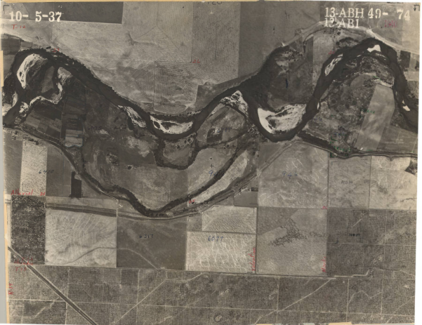 A 1937 aerial survey photo of Fresno County shows agriculture land with a river running through it.