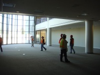 Library employees get an early tour of their new Library. The Table Mountain Rancheria Tower is seen under construction, before the iconic basket weave pattern was added.
