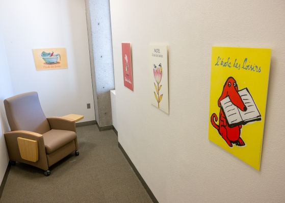 Library lactation room with chair and wall art featuring children's literature