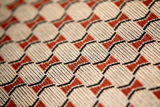 A close up of custom fabrics that were inspired by Native American basket patterns.