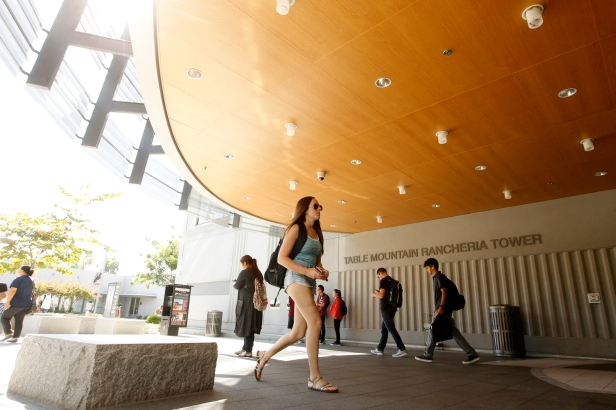 A student entering the Henry Madden Library on the first day of school.