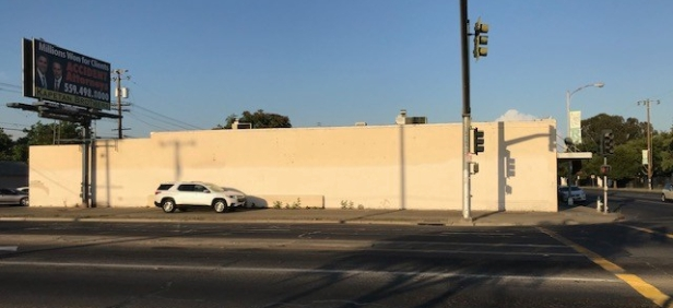 Photo of blank wall on side of business