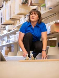 Lauren Twohey demonstrates the crash-test dummy kit at the Teacher Resource Center.