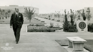 Past president Arnold E. Joyal walking by the Memorial Court.