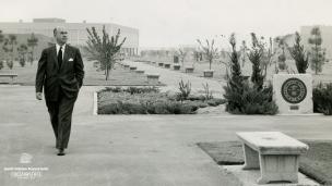 Past president Arnold E. Joyal walking by the Memorial Court.