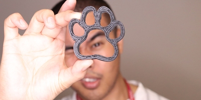 Arnel Ordonio looking through a 3d printed paw