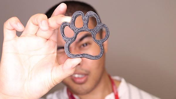 Arnel Ordonio looking through a 3d printed paw
